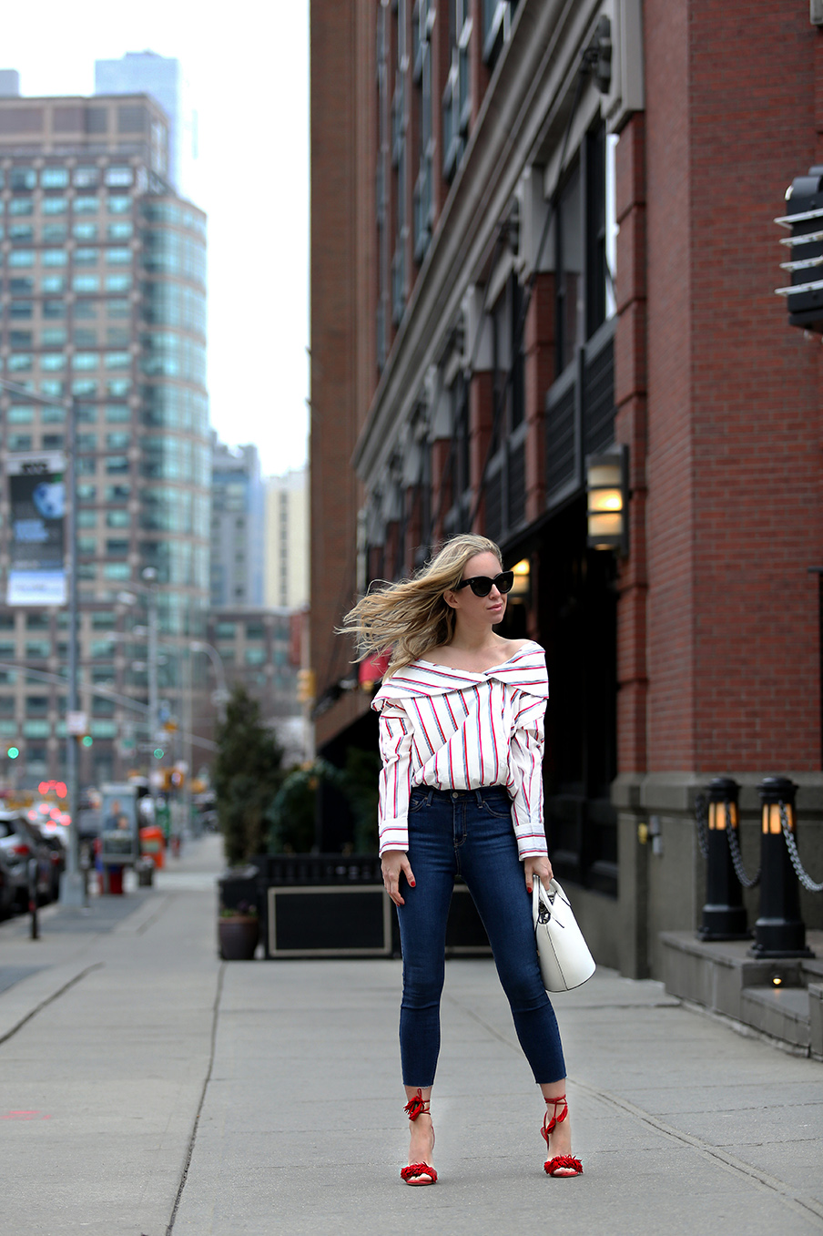 Roxy Hotel NYC Staycation - Helena Glazer of Brooklyn Blonde wearing Storets top with Topshop denim, red Aquazzura Wild Things heels, Celine sunglasses