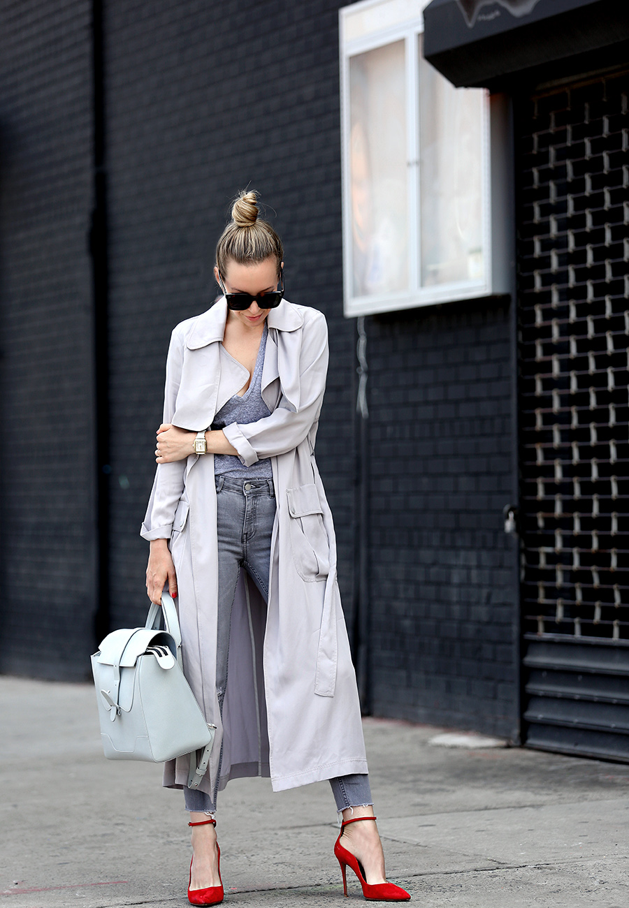 Helena of Brooklyn Blonde wearing a grey monochromatic outfit with Topshop long grey duster jacket, red Aquazzura heels, Senreve bag, MONROW tee, MICHELE watch