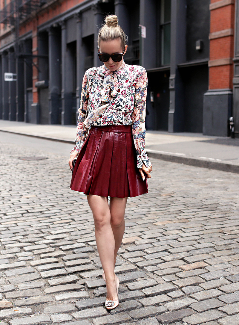 Helena Glazer of Brooklyn Blonde wearing See by Chloe floral top, Alice + Olivia maroon Leather Skirt, Manolo Blahnik shoes