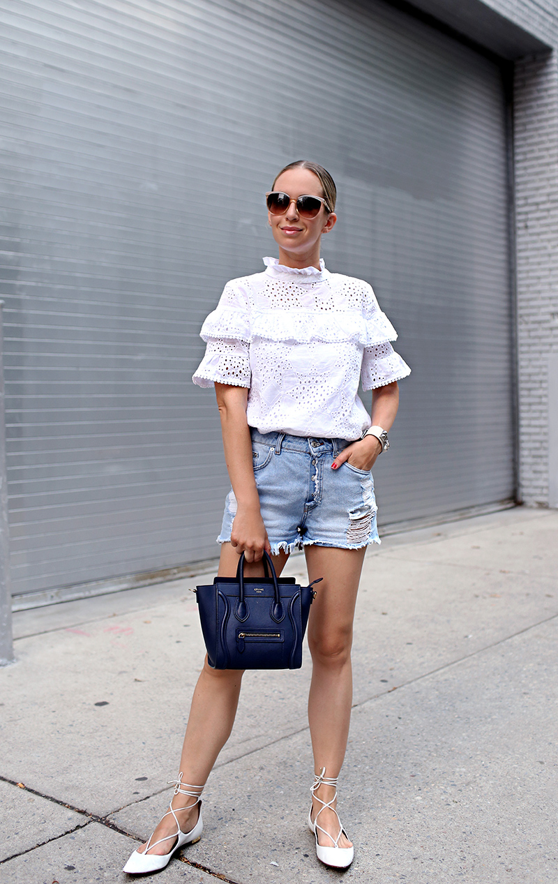 Helena Glazer of Brooklyn Blonde wearing J.O.A. white eyelet ruffled top, Zara distressed denim shorts, Aquazzura lace up flats, Hermes cuff