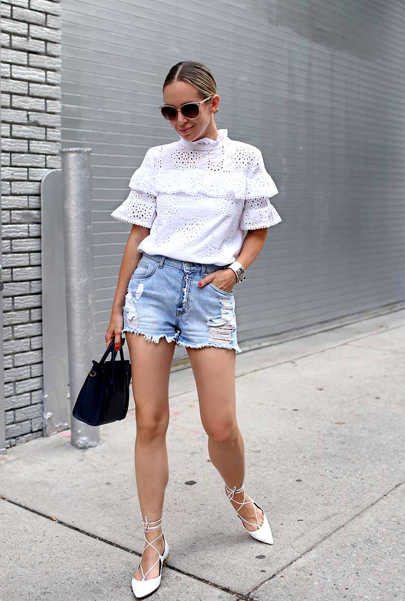 Helena Glazer of Brooklyn Blonde wearing J.O.A. white eyelet ruffled top, Zara distressed denim shorts, Aquazzura lace up flats, Hermes cuff - with son Nate wearing Target baby clothes