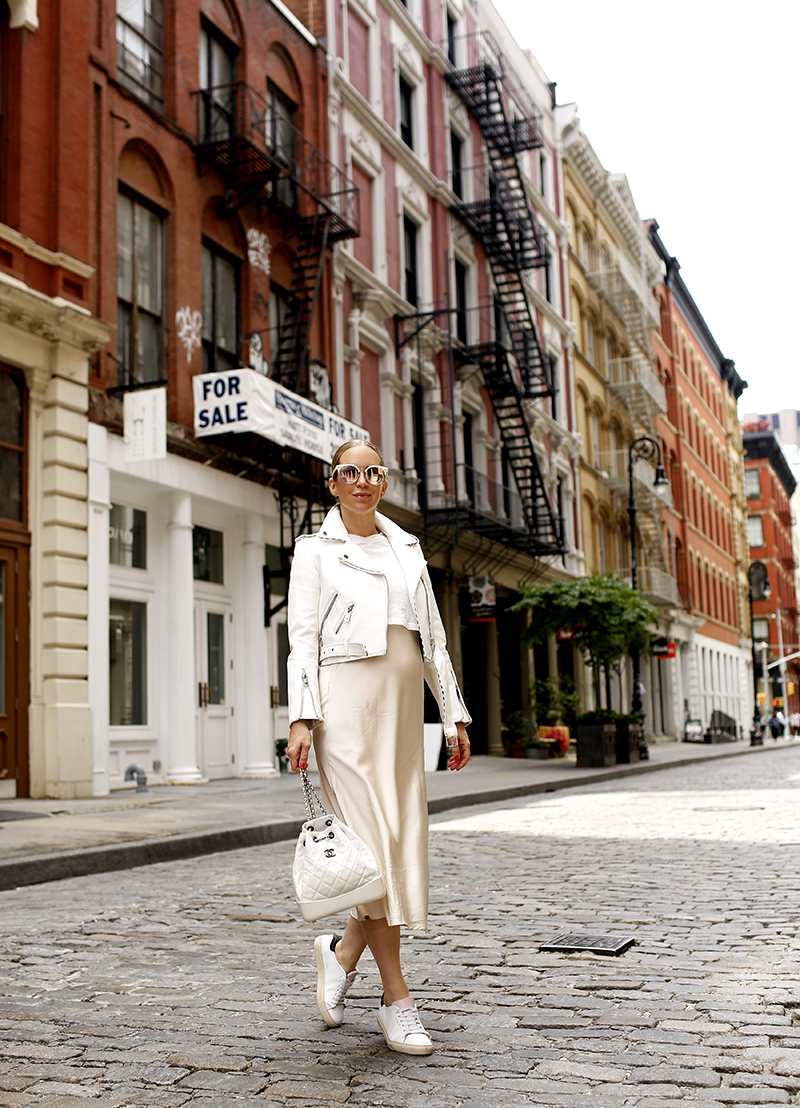 vanilla latte outfit - White Leather Biker Jacket, Beige Slip Dress, Axel Arigato White Sneakers, Chanel White Quilted Backpack, Spring Summer Maternity Outfit Idea, Helena of Brooklyn Blonde