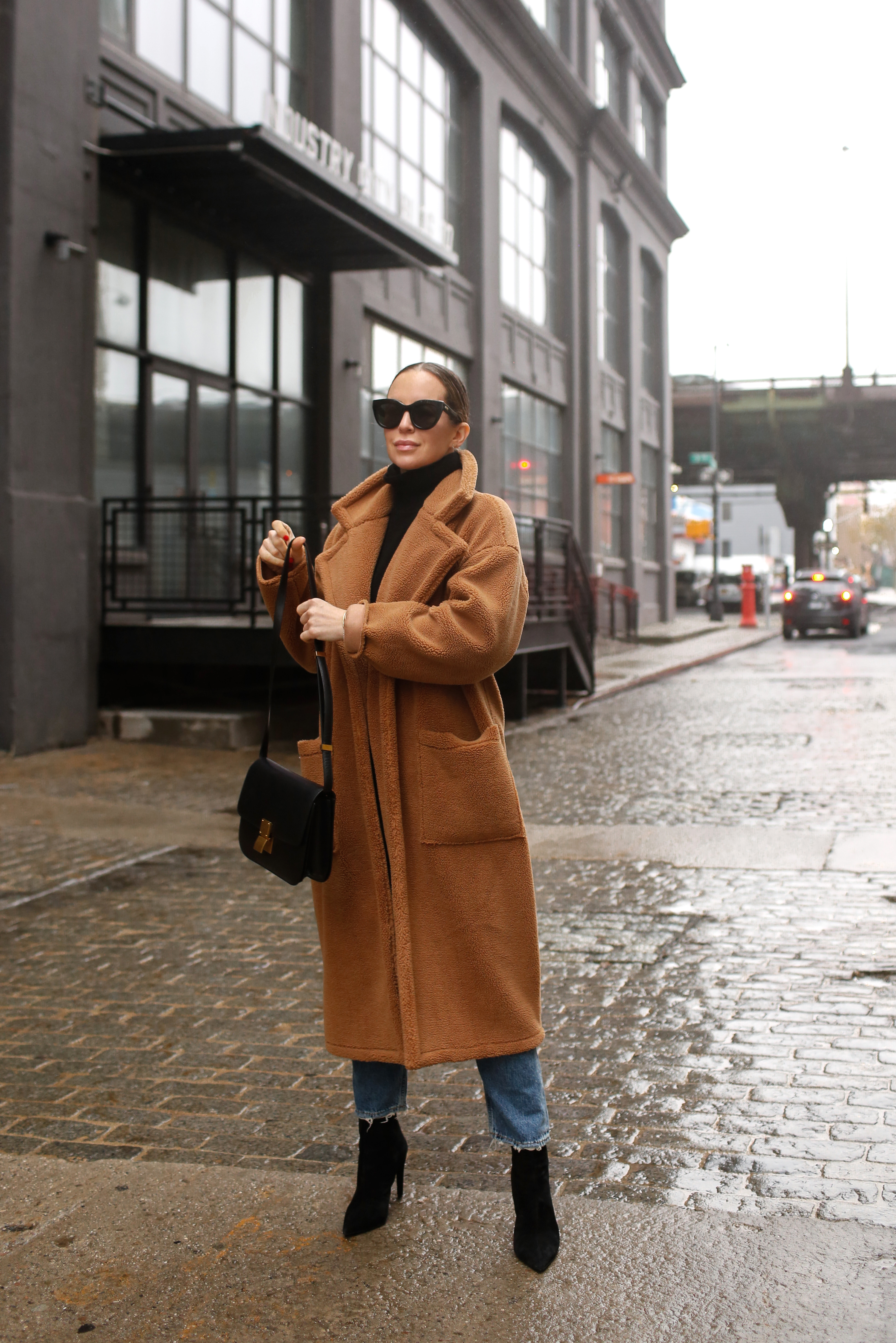 woman wearing trench coat, jeans, boots, and Favorite Pairs of Sunglasses