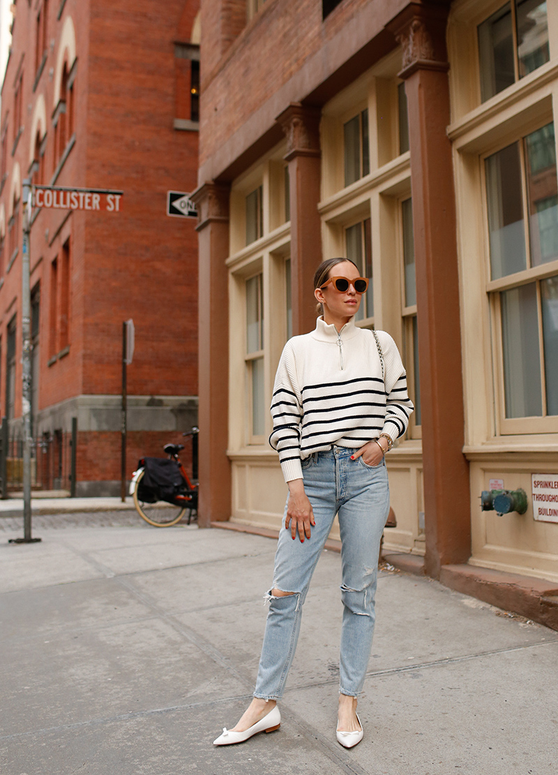 woman wearing her favorite Pairs of Denim, a sweater, and white flats