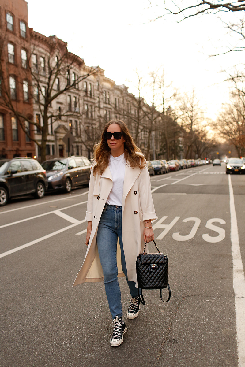 woman wearing white tshirt, jeans, and Trench Coats with Converse