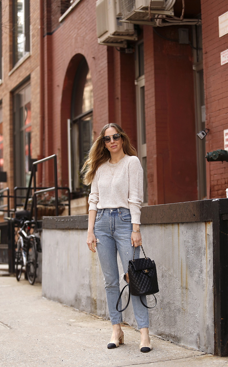 woman wearing her favorite Pairs of Denim and a sweater