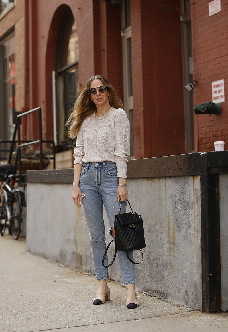 woman wearing jeans, sweater, and her favorite pair of sunglasses