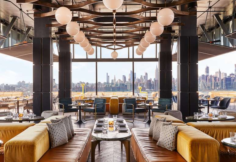 interior of a restaurant with NYC view for Night Out in NYC