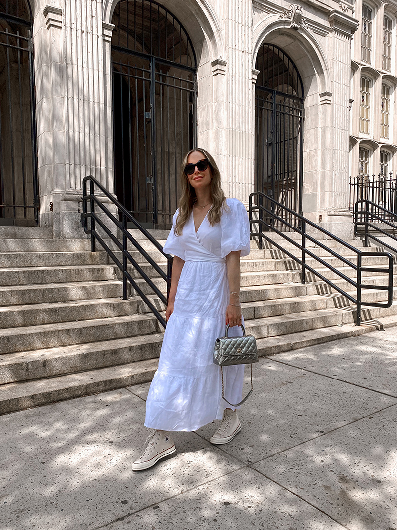 woman wearing white dresses with converse