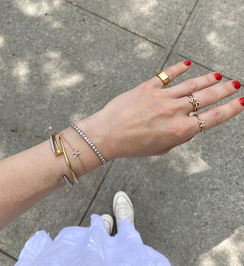 woman's hand showing Jewelry Update with rings and bracelets