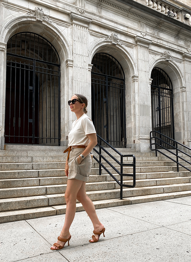 woman walking and wearing tshirt and shorts and sharing Rewrite the Rules